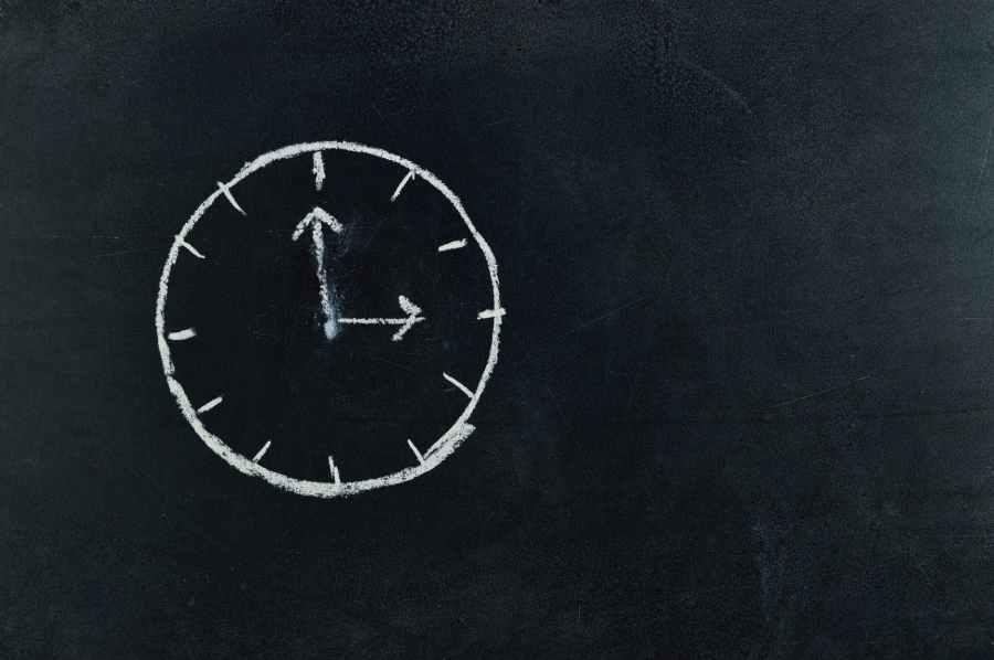 analog clock sketch in black surface